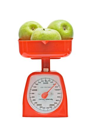 weighting: Kitchen scale weighting apples Stock Photo