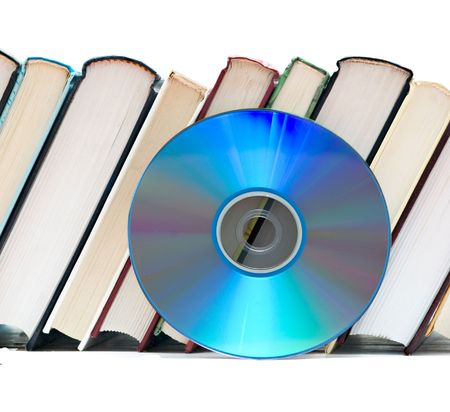 versatile: Row of books  and DVD disk as symbols of old and new methods of information storage