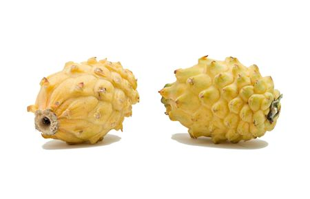 Two yellow dragon fruits isolated on white background photo