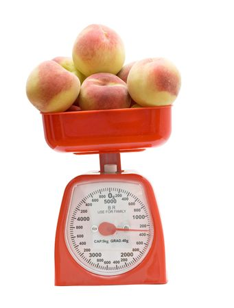 weighting: Red kitchen scale weighting peaches