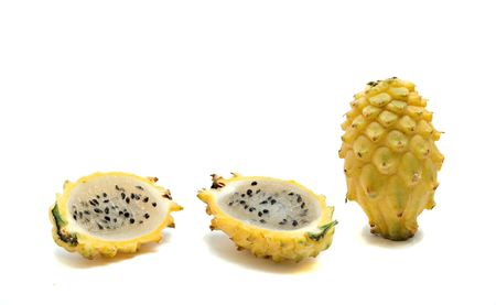Yellow dragon fruit and its sections isolated on white background photo