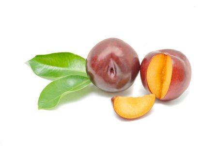 segment: Plums and segment isolated on white background