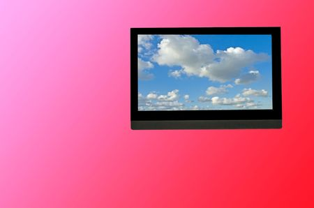 LCD TV set mounted on wall photo