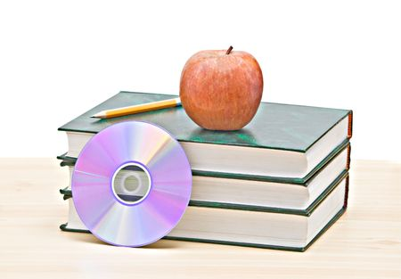 Apple, dvd, and books as a symbol of transition fron old to new ways of learning photo