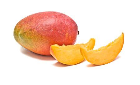 superfruit: Mango and two segments isolated on white background