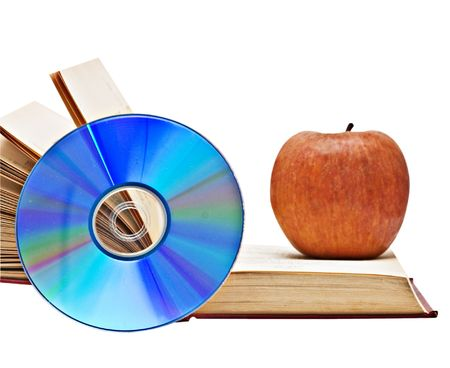 Apple, dvd, and open book as  symbols of transition fron old to new ways of learning photo