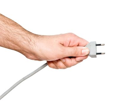 Hand with two-pin power plug photo