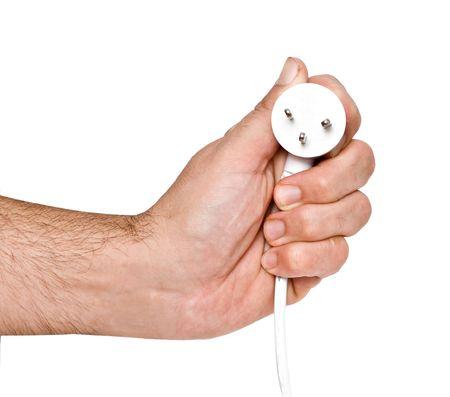 Hand with three-pin power plug photo