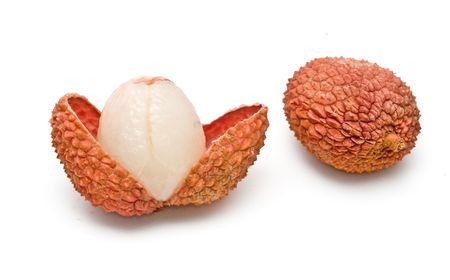 Lychee and peeled lychee isolated on white background photo