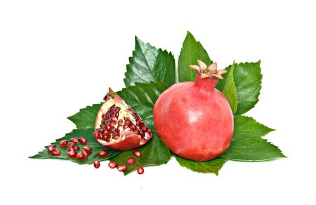 superfruit: Ripe pomegranate and its section isolated on white background