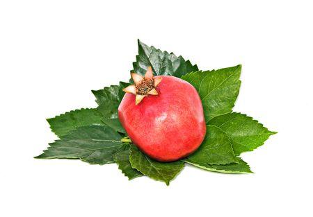 superfruit: Ripe pomegranate isolated on white background