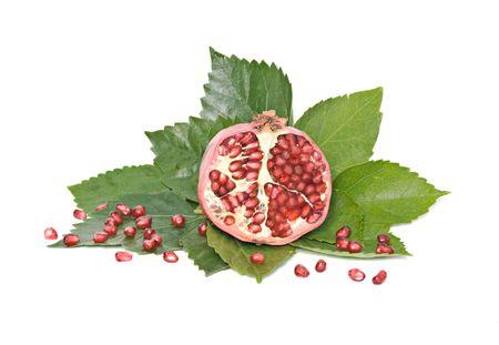 superfruit: Ripe and section pomegranate isolated on white background