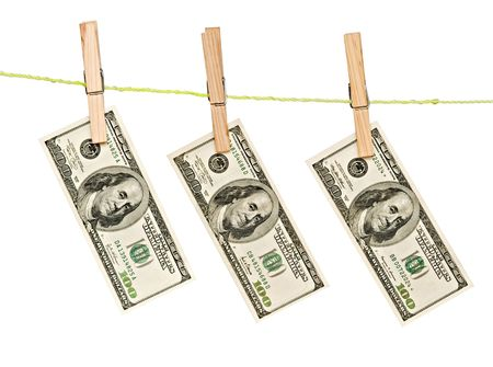 Dollar banknotes drying after laundry on rope Stock Photo - 5396775