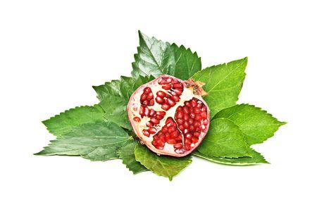 superfruit: section of ripe pomegranate isolated on white background Stock Photo