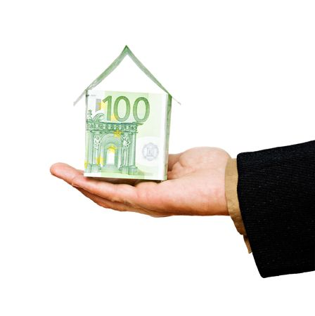 Money house in hands photo