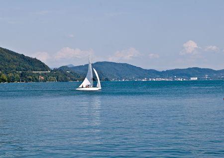 sailling: Boat sailling along shore Stock Photo