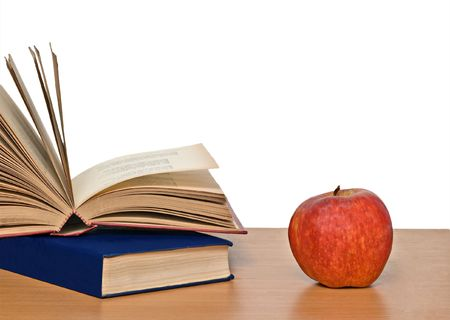 Red apple and books on desk Stock Photo - 5837536