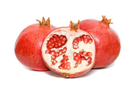 superfruit: Ripe pomegranates  and section isolated on white background