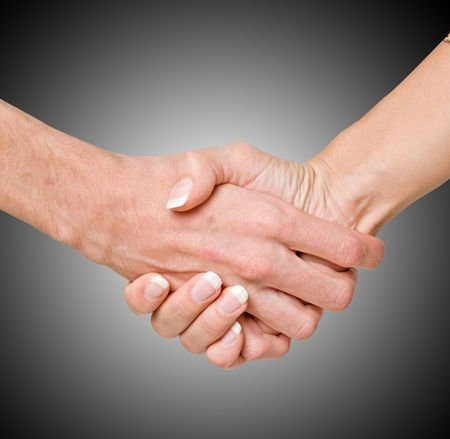 Handshaking man and woman Stock Photo - 6080842