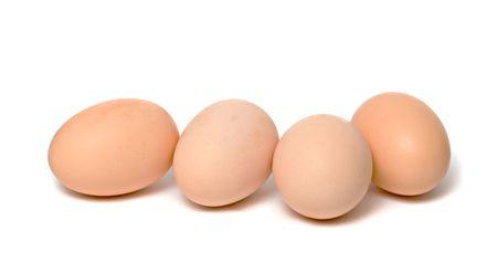 Four eggs isolated on white background photo