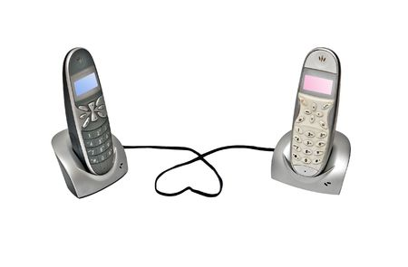 Two cordless telephone on its base photo