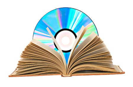 Pile of books, open book,  and DVD disk as symbols of old and new methods of information storage photo