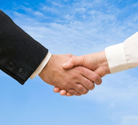Handshaking man and woman Stock Photo - 6640795