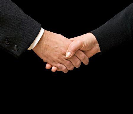 Handshaking man and woman photo