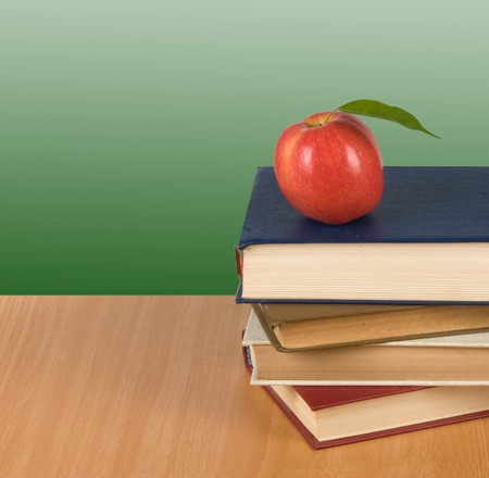 Red apple on  books photo
