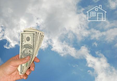 house exchange: Dollars in hand  Stock Photo