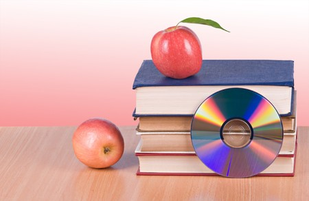 rewritable: Apples, dvd, and  books as  symbols of transition fron old to new ways of learning