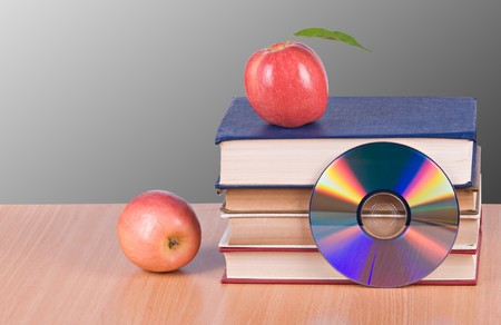 Apples, dvd, and  books as  symbols of transition fron old to new ways of learning photo