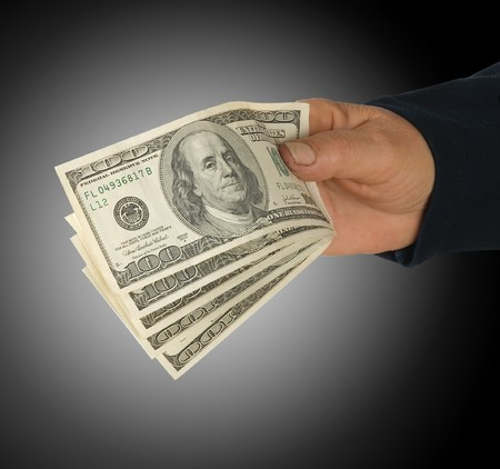 creditor: Hand with dollars