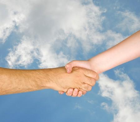 Handshaking man and girl photo