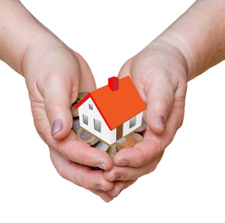 Hands with gift of money and house photo