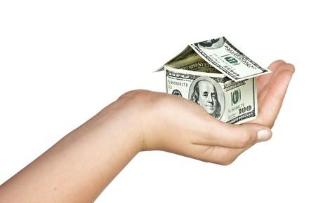 housing estates: Casa di denaro in mano