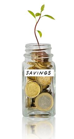 saving tips: Jar with savings Stock Photo