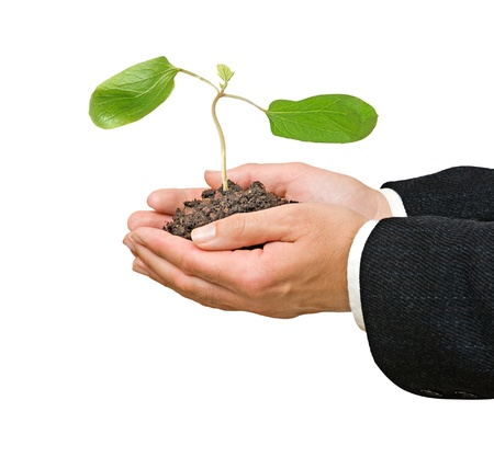 Farmer with gift of sapling of castor oil plant Stock Photo