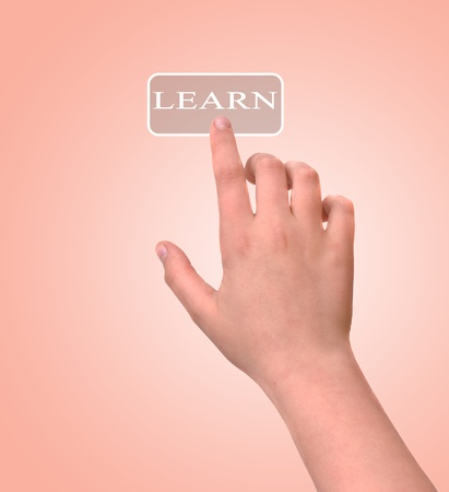 Girl pressing learn button photo
