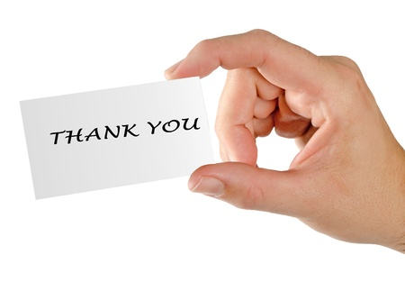 Hand with thank you note photo