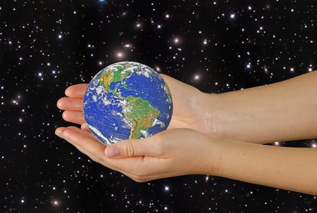Planet earth on palms.Elements of this image furnished by NASA Stock Photo - 12992205