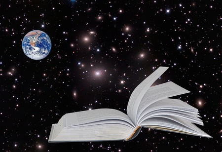 Planet Earth on book.Elements of this image furnished by NASA photo