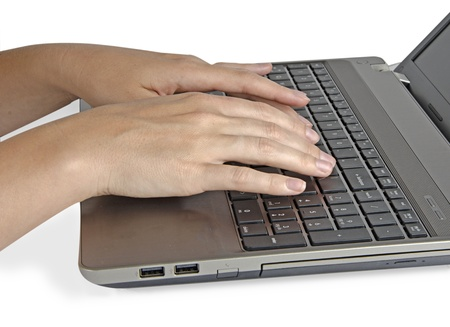 Woman typing on notebook photo