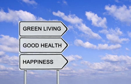 Road sign to green living, good health and happiness photo