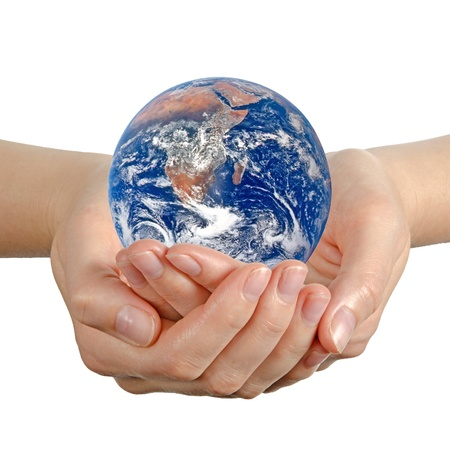 Planet earth in hand Elements of this image furnished by NASA photo