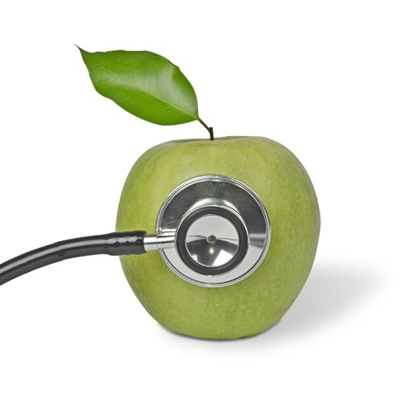 Green apple with stethoscope photo