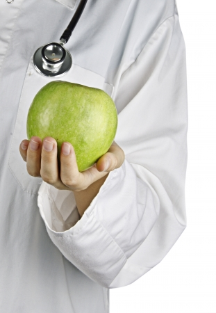 Apple in doctor's hand photo