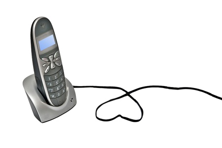 cordless telephone on its base photo