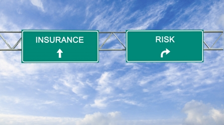 risks ahead: Road signs to insurance and risk Stock Photo