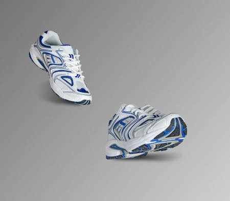 Sneakers isolated on grey background photo